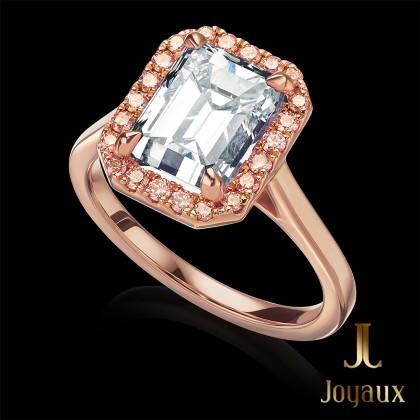 3/4 CT. Emerald cut diamond with pink diamond surround
